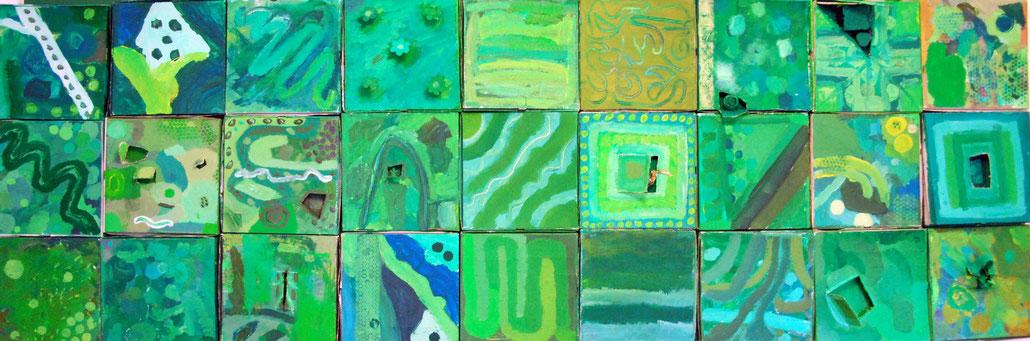 Mosaik aus bemalten Pizzakartons