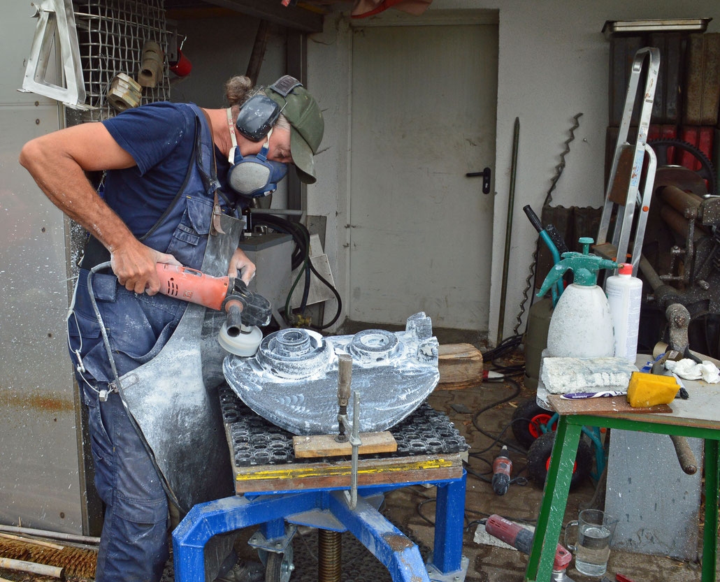 Sculptor HEX working on an abstract sculpture called PAGAN MASKS in black granite. ABBY HIGNELL has a gallery in London. HEX is a Fellow of the Royal British Society of Sculptors