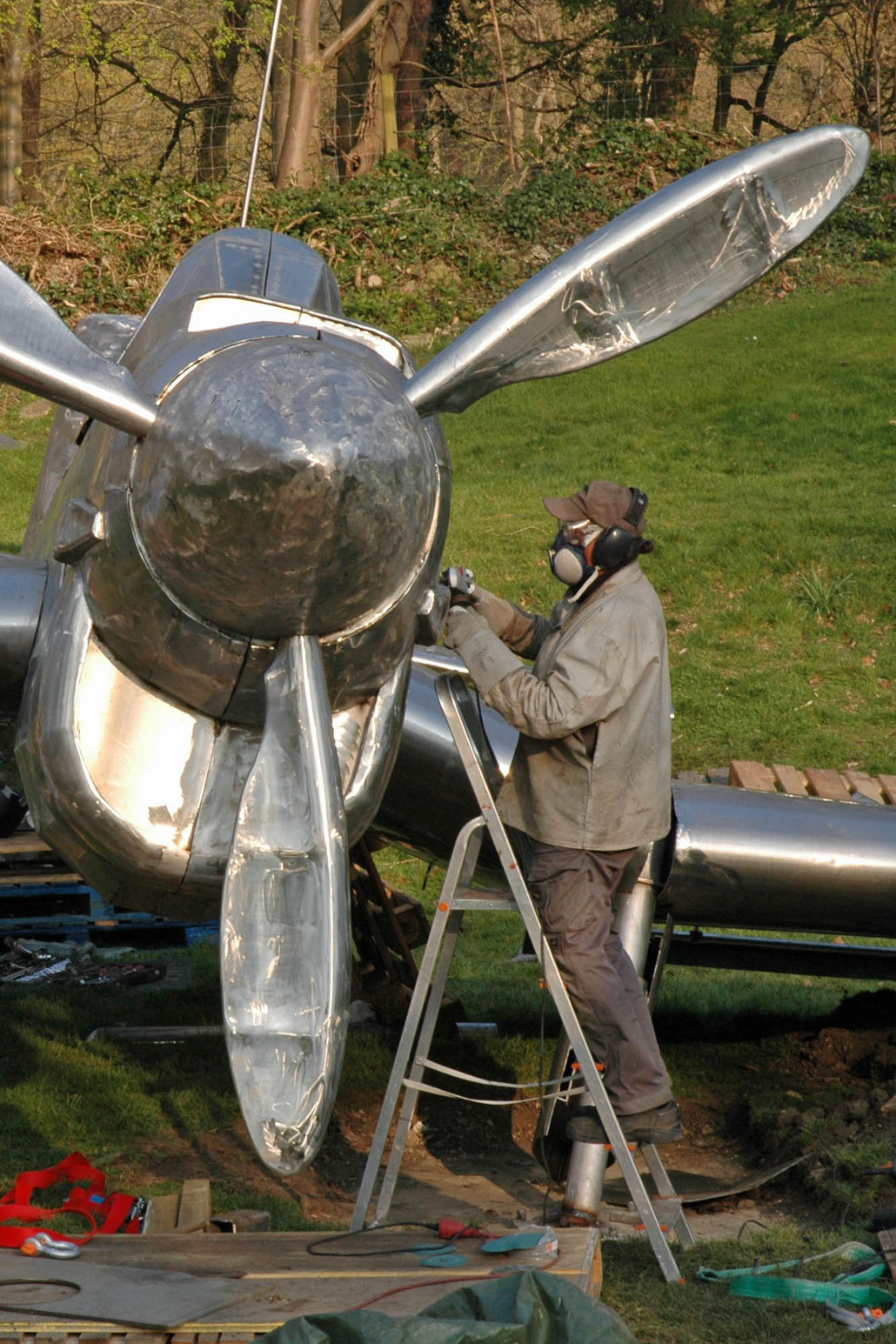 Sculptor HEX working at his STUKA sculpture at Burghley House Sculpture Park. This work is a memorial for the Battle of Britain. HEX is a Fellow of the Royal British Society of Sculptors.