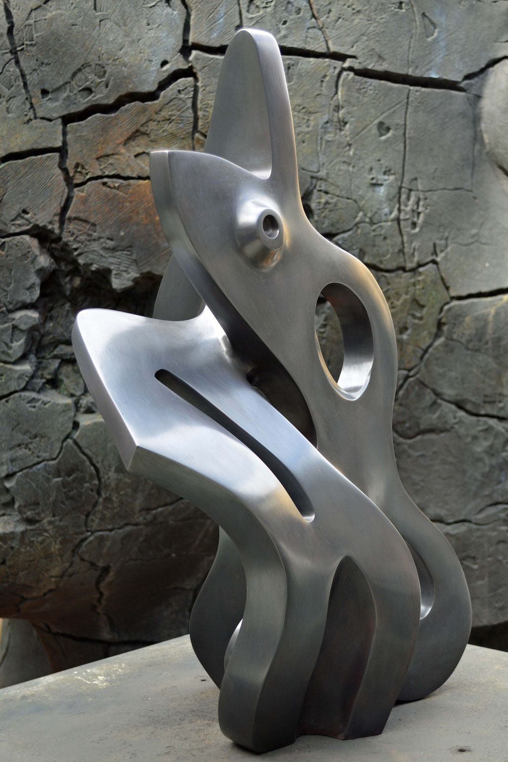 The background for this abstract contemporary sculpture is a huge bronze of Igor Mitoraj. Hex is a Fellow of the ROYAL BRITISH SOCIETY OF SCULPTORS