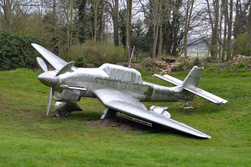 Contemporary sculpture of a crashed STUKA JU 87 by sculptor HEX at Burghley House, Stamford. HEX is a Fellow of the Royal British Society of Sculptors.