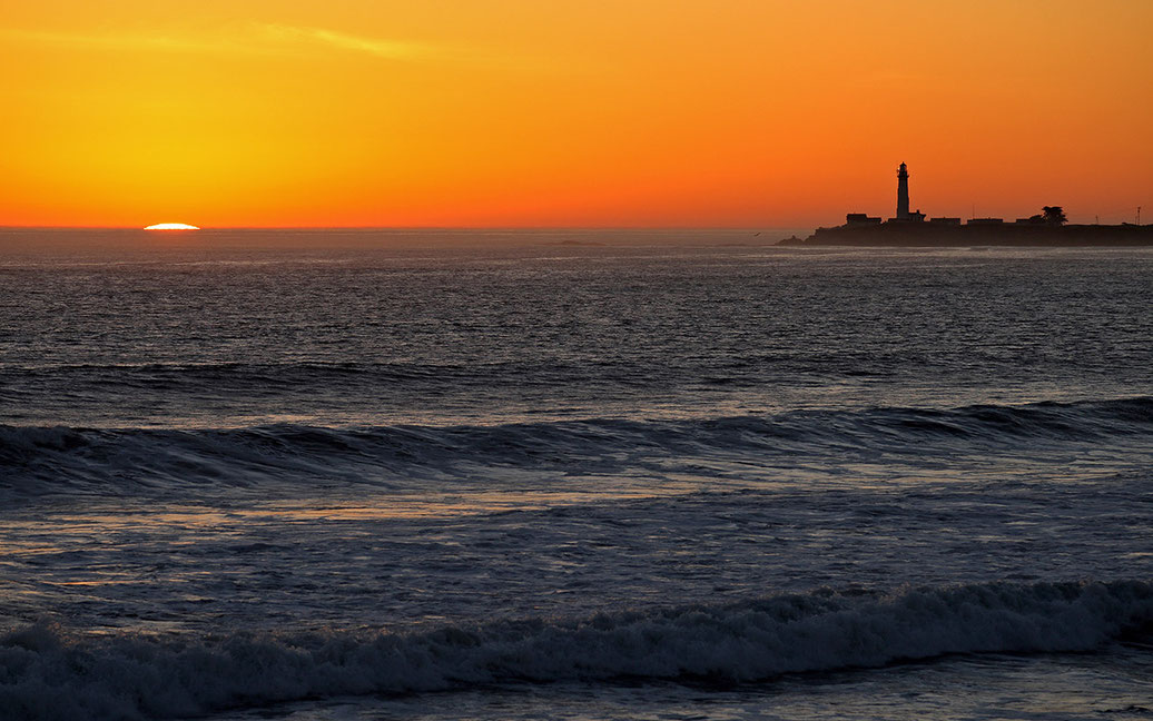 Beautiful Pigeon Point Lighthouse at sunset at the Pacific Ocean with setting sun and warm colors, San Jose, California, USA, 1280x801px