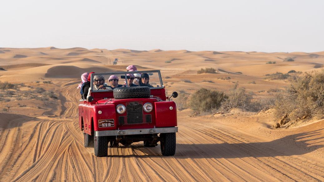 Red old Land Rover in desert