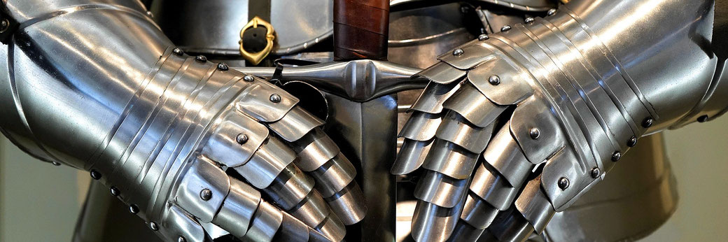 Medieval plate armour with sword