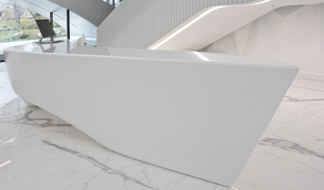Sculpture-like solid surface reception in the foyer of a business centre in Vilnius is a true work of art
