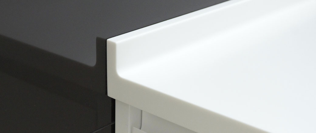 Solid surface bathroom vanity with an elevated edge from water droplets can be joined seamlessly