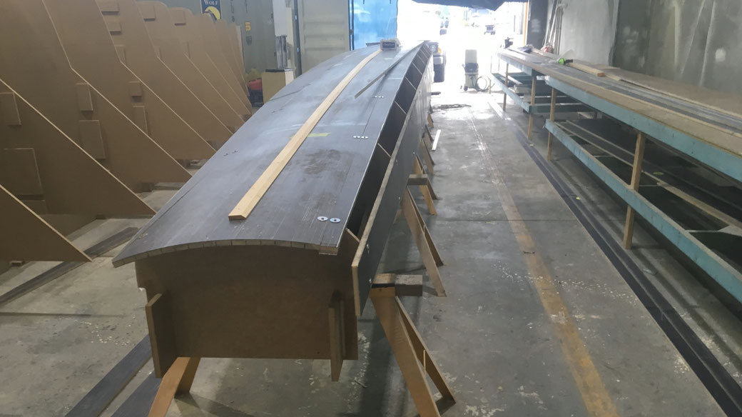 Strips of PVC foam with carbon unis both sides as planking for a 42' trimaran hull