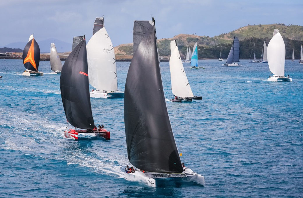 Catamarans Mad Max and Boatworks leading the fleet at Hamilton Island Race Week