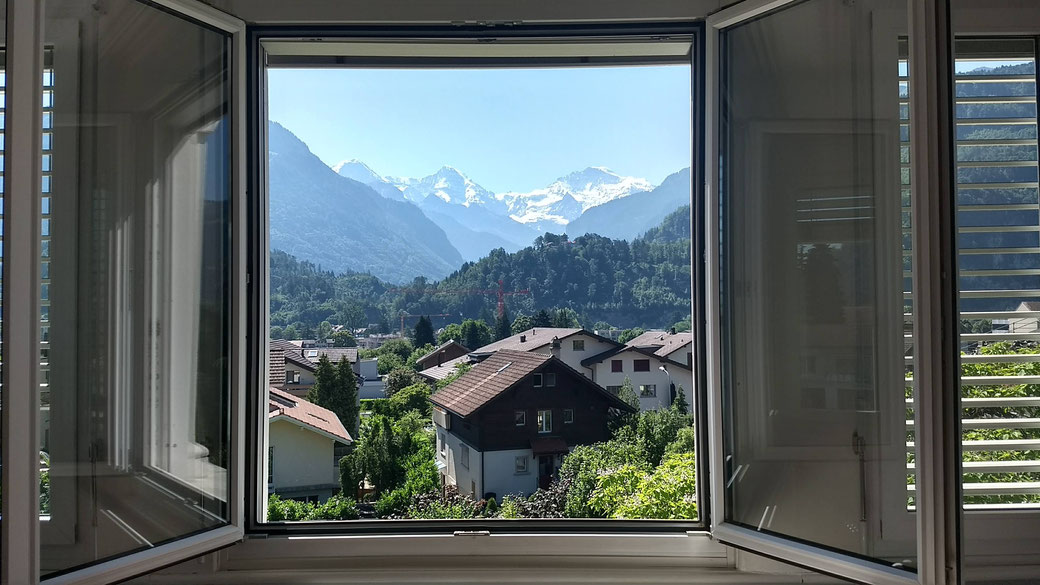 because of these views did the 5-star Victoria Jungfrau hotel want to build their hotel on the location of the Adventure hostel Interlaken