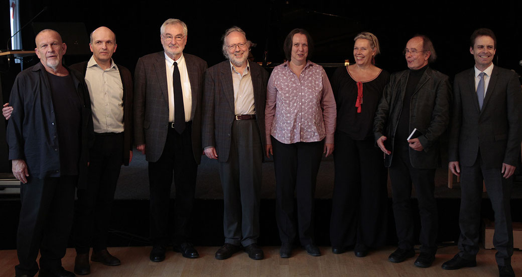 "From the left: Peter Michael Hamel, Christoph Schlüren, Ernst Pöppel, Wolfgang Andreas Schulz, Christa Bützberger, Mareile Vaupel, Michael von Brück, Patrick Lang in ""Freies Musikzentrum"" in Munich"