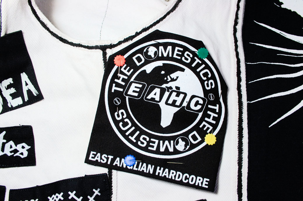 5 ways to sew on patches - pin patch onto vest - Zebraspider Eco Anti-Fashion Blog