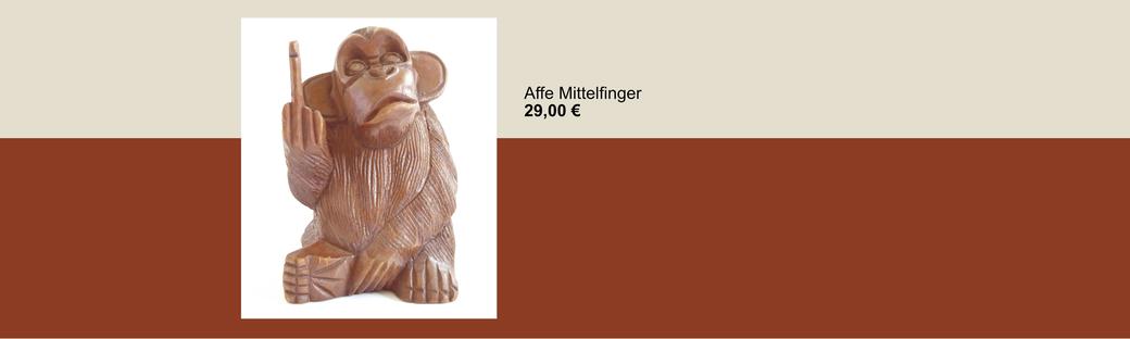 Dekoration Affe aus Holz geschnitzt, zeigt den Mittelfinger