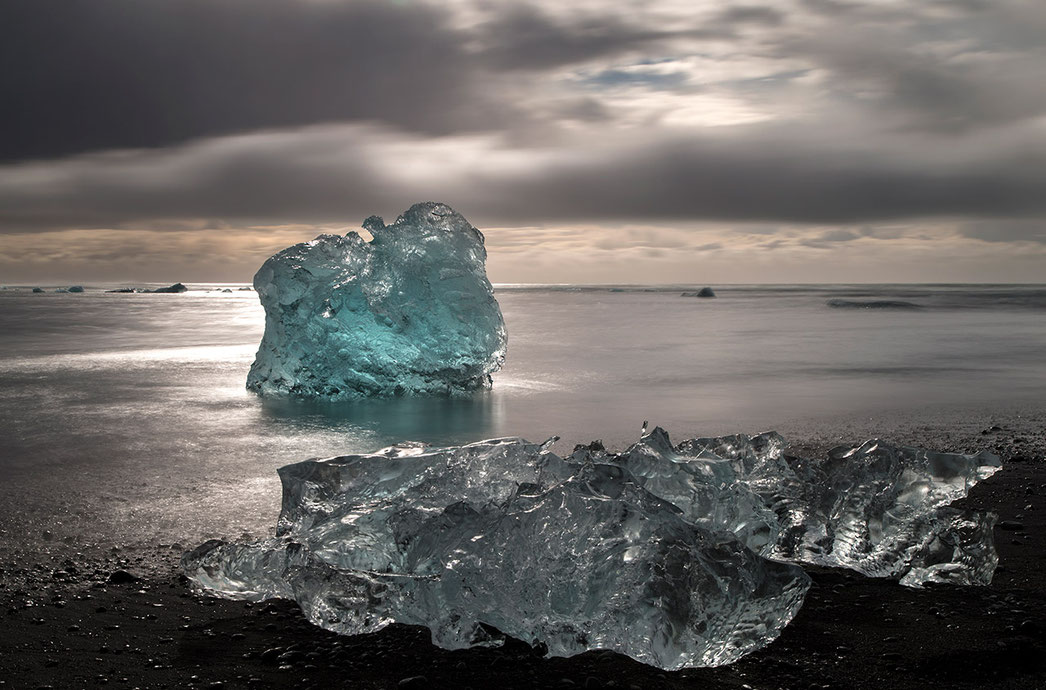 Ice rocks and the black sand at diamond beach close to Jokulsarlon, Atlantic Ocean, Iceland