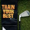 """Schlägertuch Trifold """"Train Your Best"""" Schwarz/Orange"""