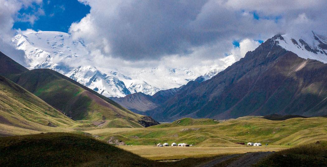 Kyrgyzstan: view of the Lake Tulpar-Kul, Behind the Lenin Peak in Tajikistan