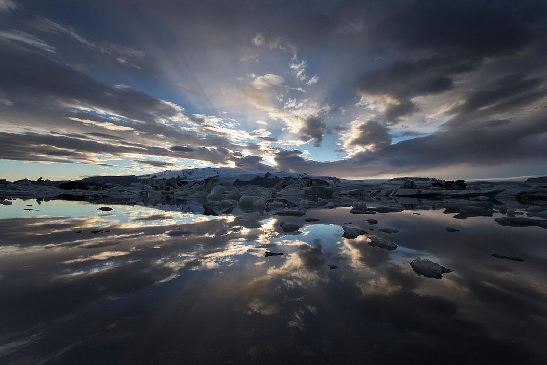 Sun rays and ice reflecting during sunset at the fascinating Jokulsarlon Glacier Lagoon, Austurland, Iceland
