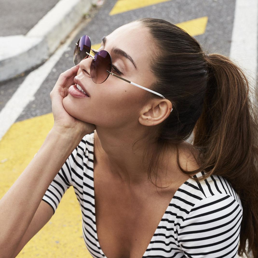 aktuelle runde randlose Sonnebrille