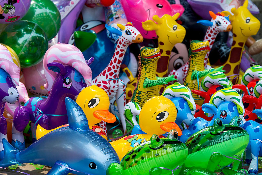 Colorful balloons with different shapes on a market in Oaxaca, Mexico, 1280x853px