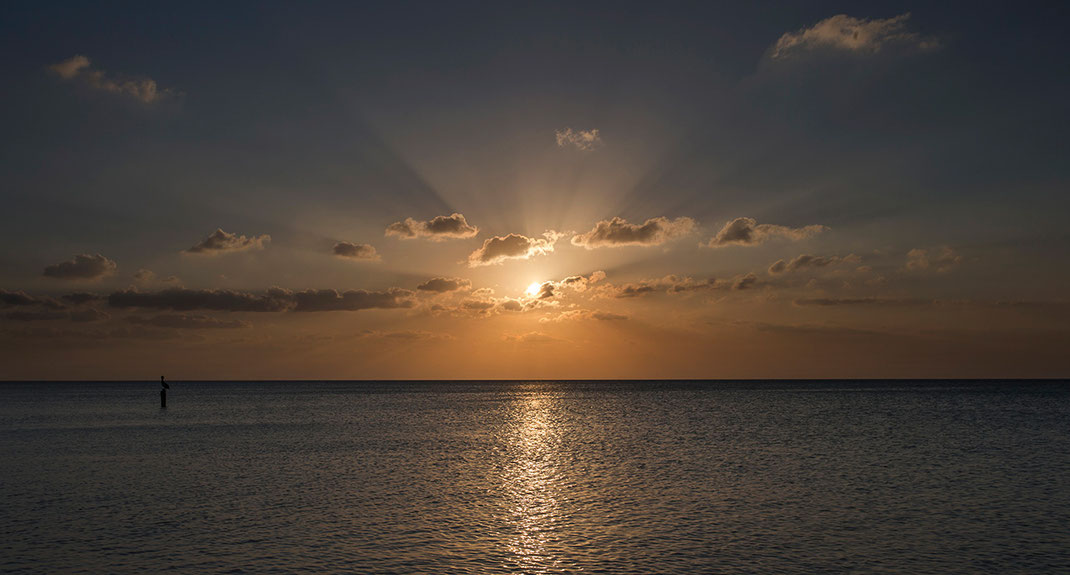 Beautiful yellow sun setting in the Gulf of Mexico, Island Holbox, Yucatan Peninsula, Mexico, 1280x688px