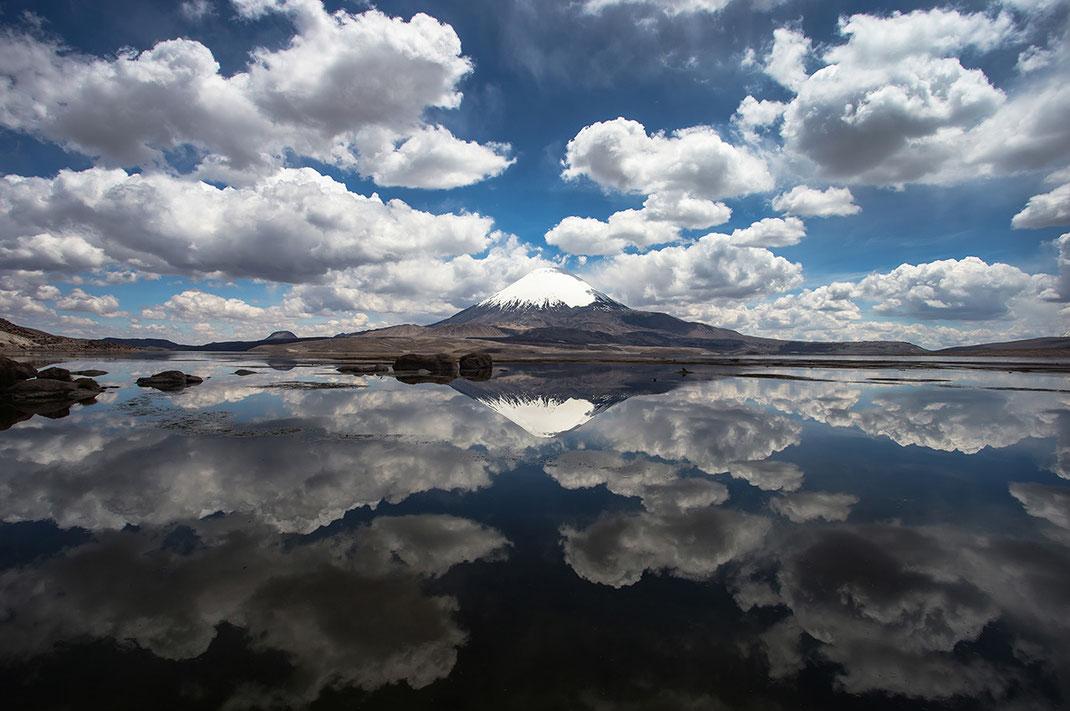 Beautiful clouds reflecting in a lake at vulcan Parinacota, Putre, Parque Nacional Lauca, Chile. 1280x850px