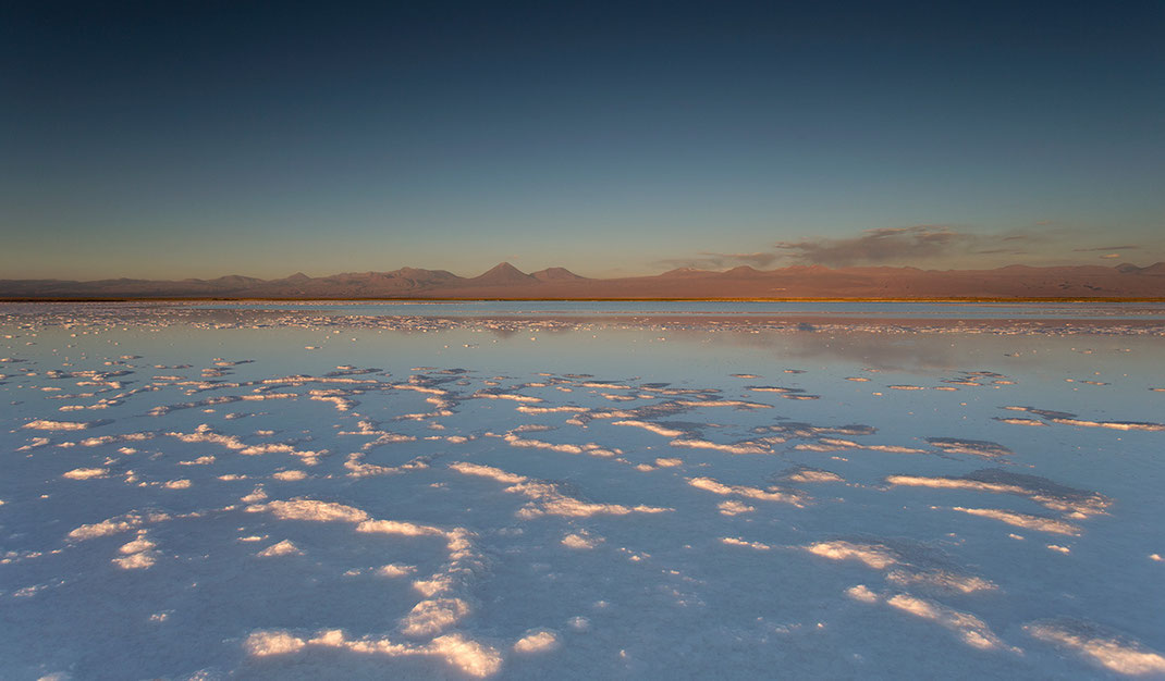 Laguna Piedra with white salt at sunset and glowing mountains, San Pedro de Atacama, Desert, Chile, 1280x749px