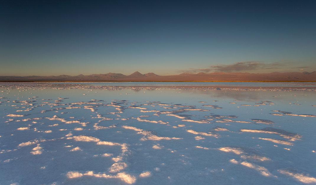Laguna Piedra with white salt at sunset and glowing mountains, San Pedro de Atacama, Desert, Chile, 1280x749px