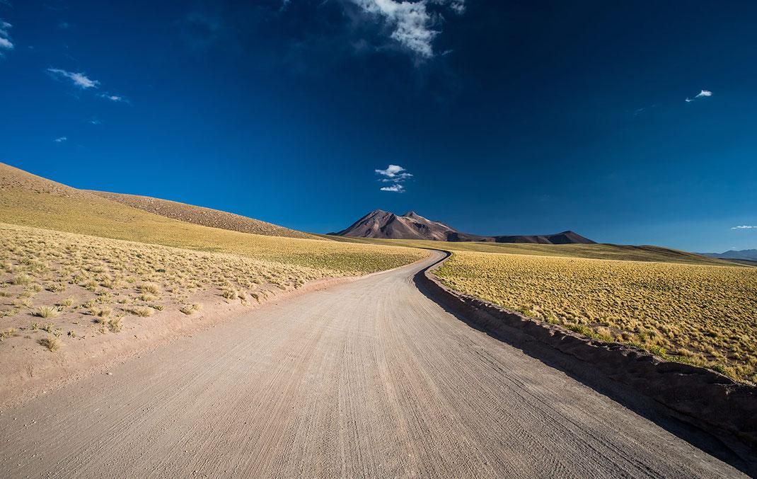Dirt road winding through the desert to Laguna Miscanti close to San Pedro de Atacama, Desert, Andes, Chile, 1280x810px