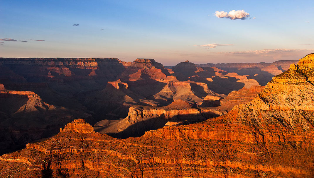 Beautiful colors at sunset at Grand Canyon National Park with layers of red colored rock, Arizona, USA, 1280x727px