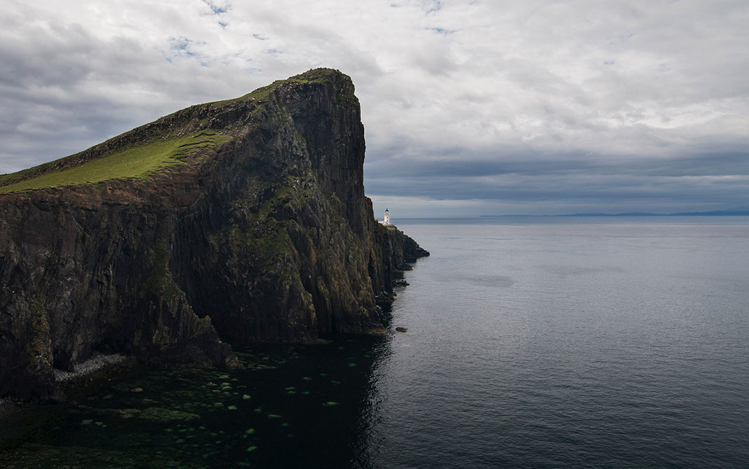 Neist Point Lighthouse on a cliff with ocean, Isle of Skye, Scotland, wide angle picture, 1280x802px