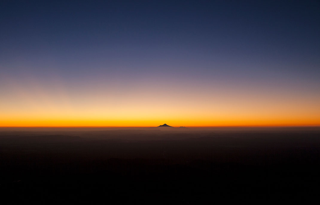 Mount Taranaki, Egmont Sunset with beautiful Sky above the clouds and fog, Northern Island, New Zealand, 1280x820px
