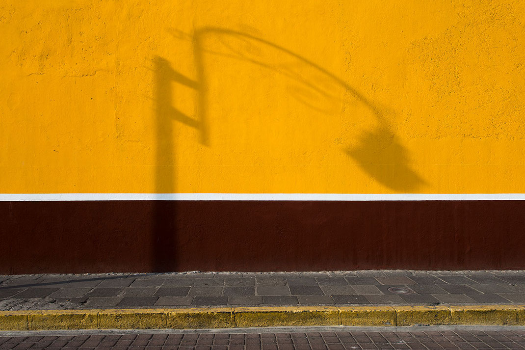 Yellow wall with abstract lamp shadow, Pueblo, Mexico, 1280x853px