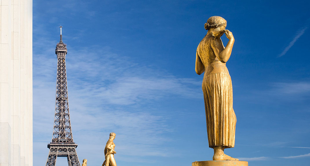 Golden sculptures with the Eiffel Tower in the background, Musee de l' Homme, Paris, France