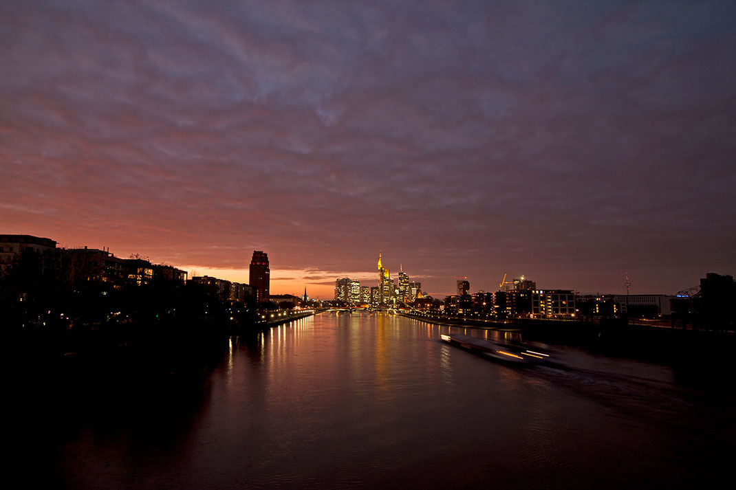 Illuminated Frankfurt Skyline with Main river and dramatic colored sky, sunset, Long Exposure, 1280x853px