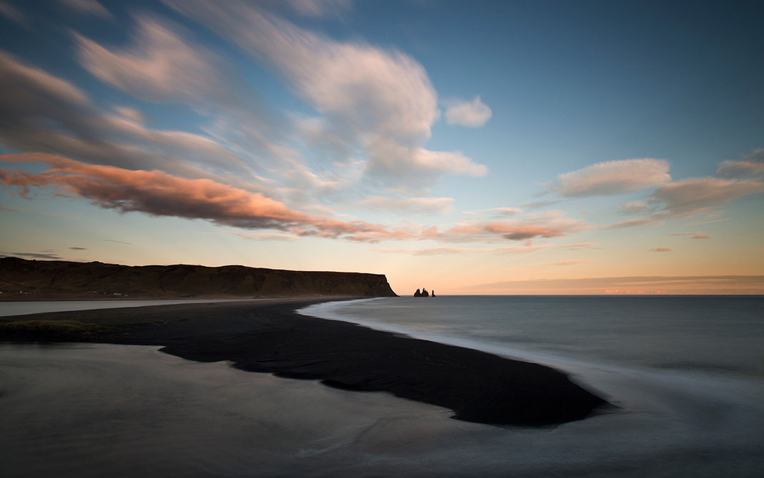 Sunset view from Dyrholaey to Vik with rocks and beautiful sky, long exposure, Sudurland, Iceland