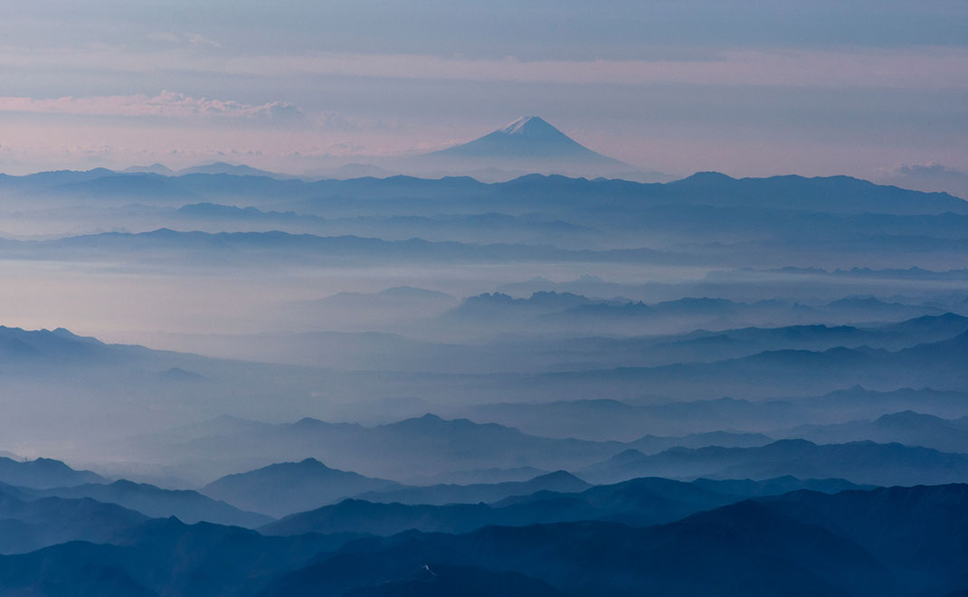 Beautiful mountain Fuji with layers of mountains and fog as seen from a plane, landscape, national symbol, Japan, 1280x790px