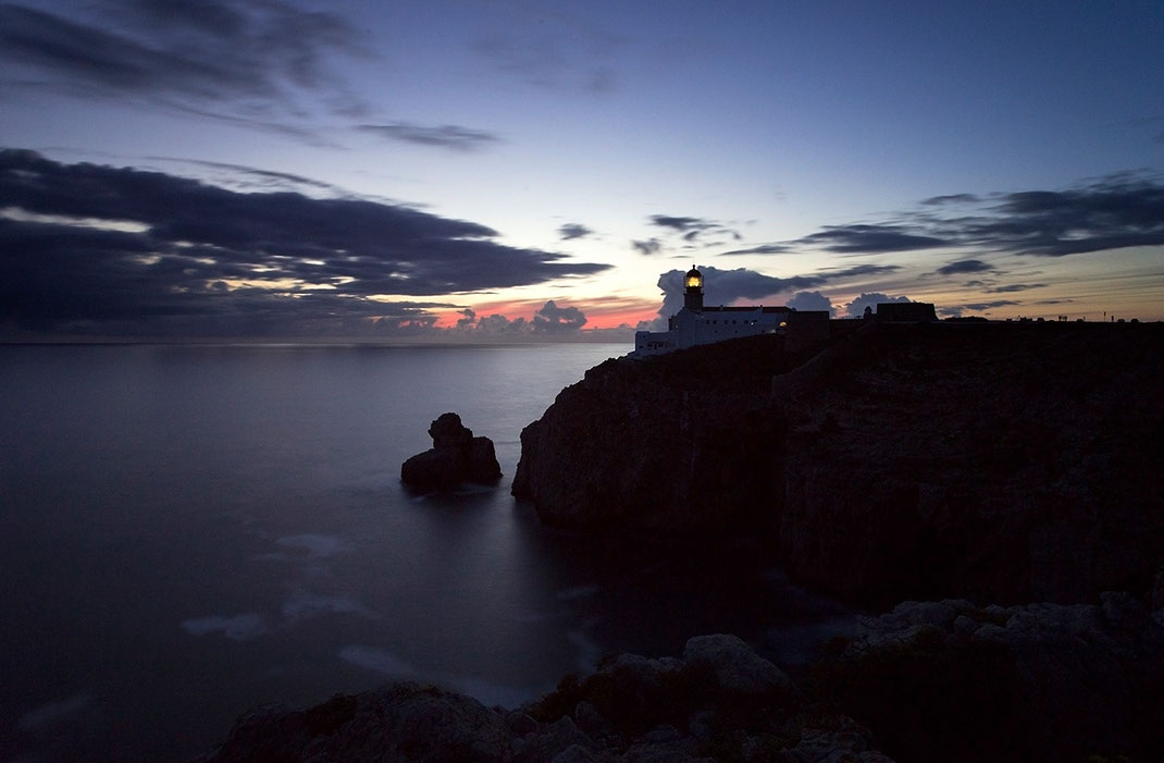 Lighthouse after sunset on rocks at the ocean, western most point, Algarve, Portugal, 1280x839px