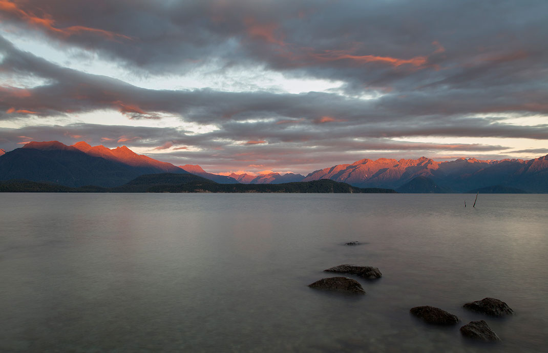 Sunrise with Red Glowing Mountain tops in Fjordland, Southern Island, New Zealand, 1280x824px