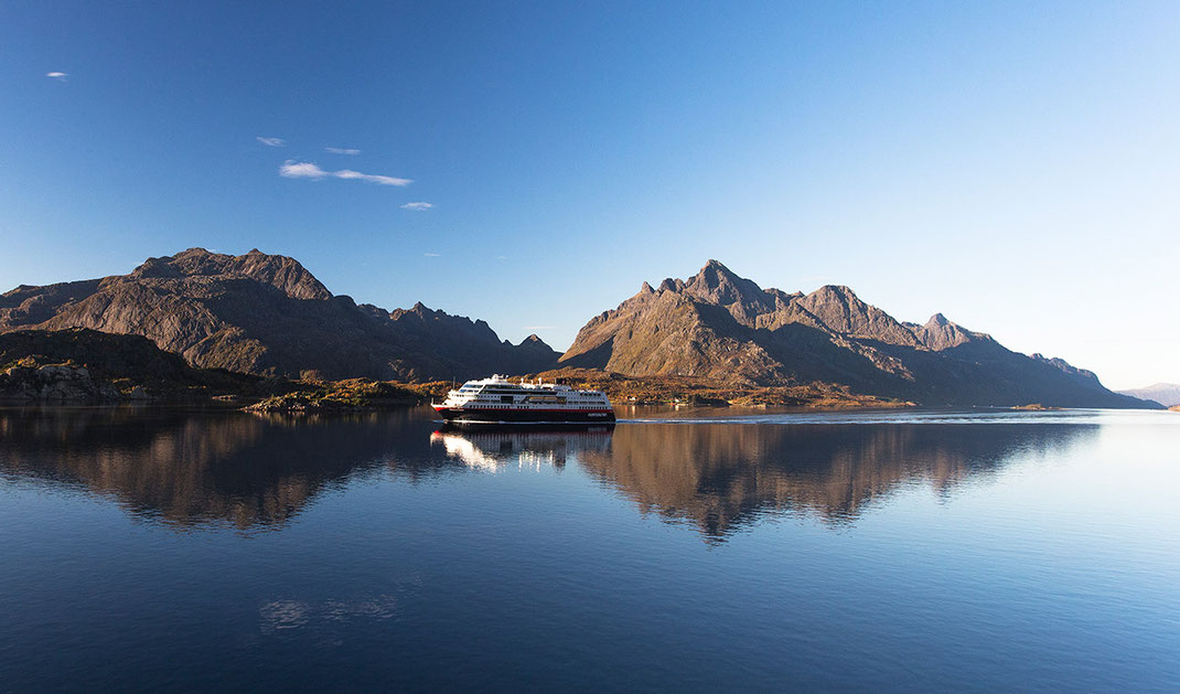 Hurtigruten cruise boat passing beautiful Troll Fiord in sunshine, Lofoten Islands, Norway, 1280x753px