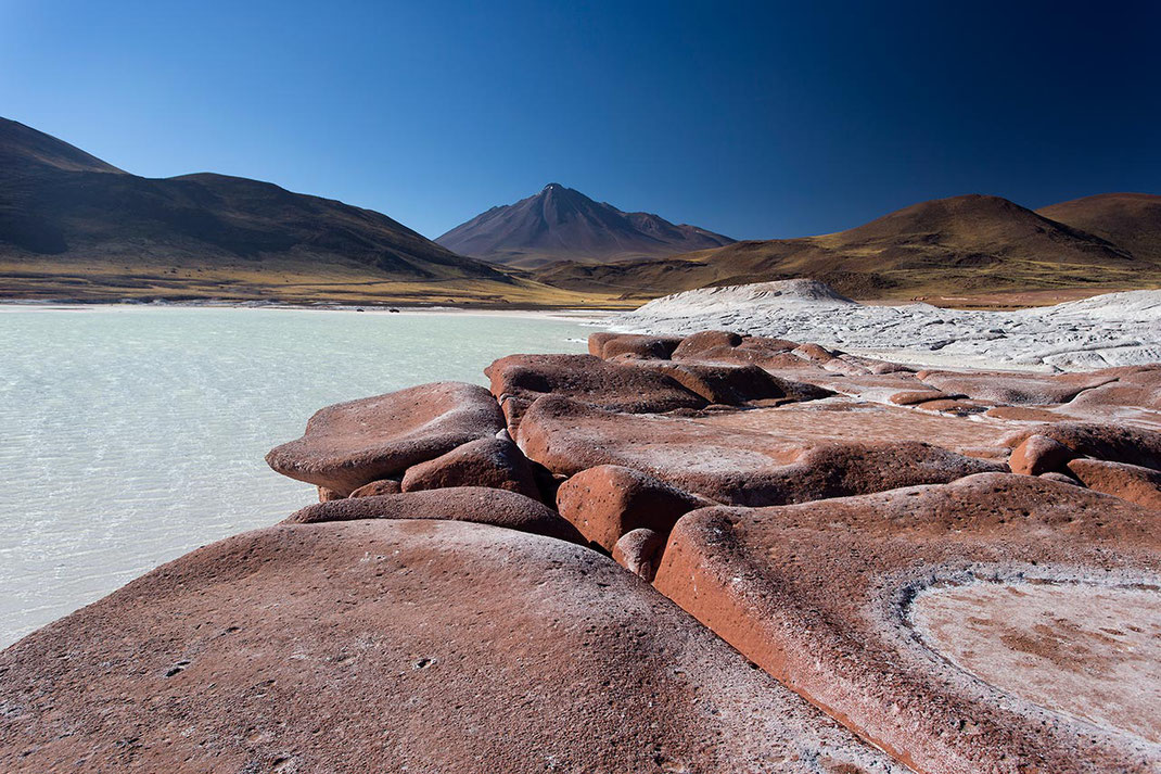Piedras rojas san rocks with vulcan in the back and salt lake, San Pedro de Atacama, Desert, Chile, 1280x853px