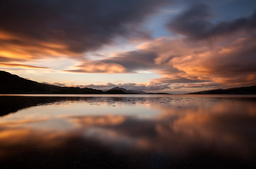 Sunset Isle of Skye, Scotland at a bay with beautiful orange colors and reflection in the water, 1280x846px