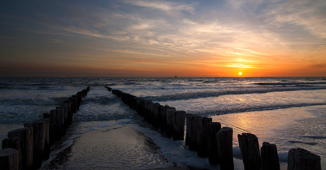 Wooden Jetty at a beach leading into the sunset on beautiful Texel Island, Holland, Netherlands 1280x670px
