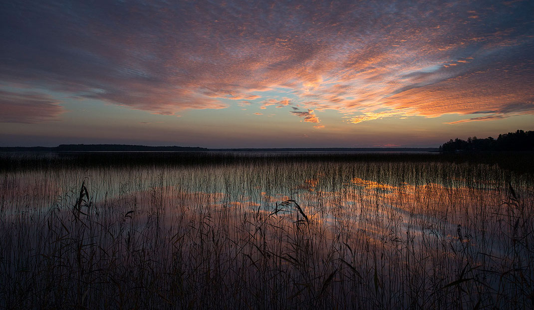 Colorful sunrise at a lake in Gaevle, Sweden, Scandinavia with warm colors in the sky