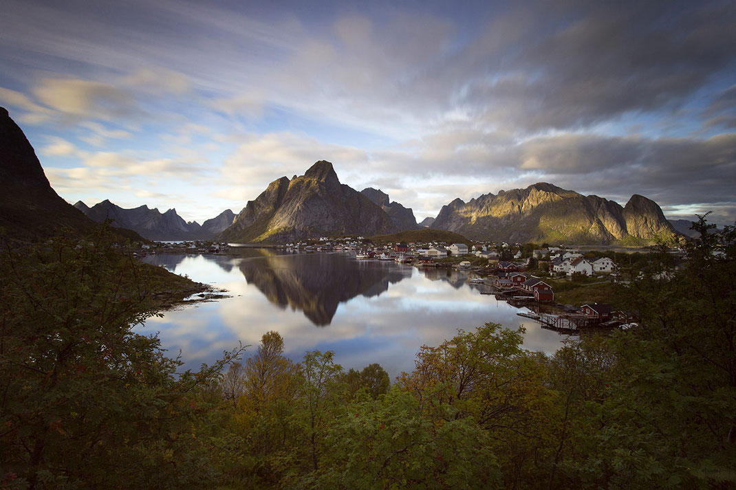 Beautiful Reine village surrounded by mountains and ocean water, long exposure, Lofoten Islands, Norway, 1280x853px