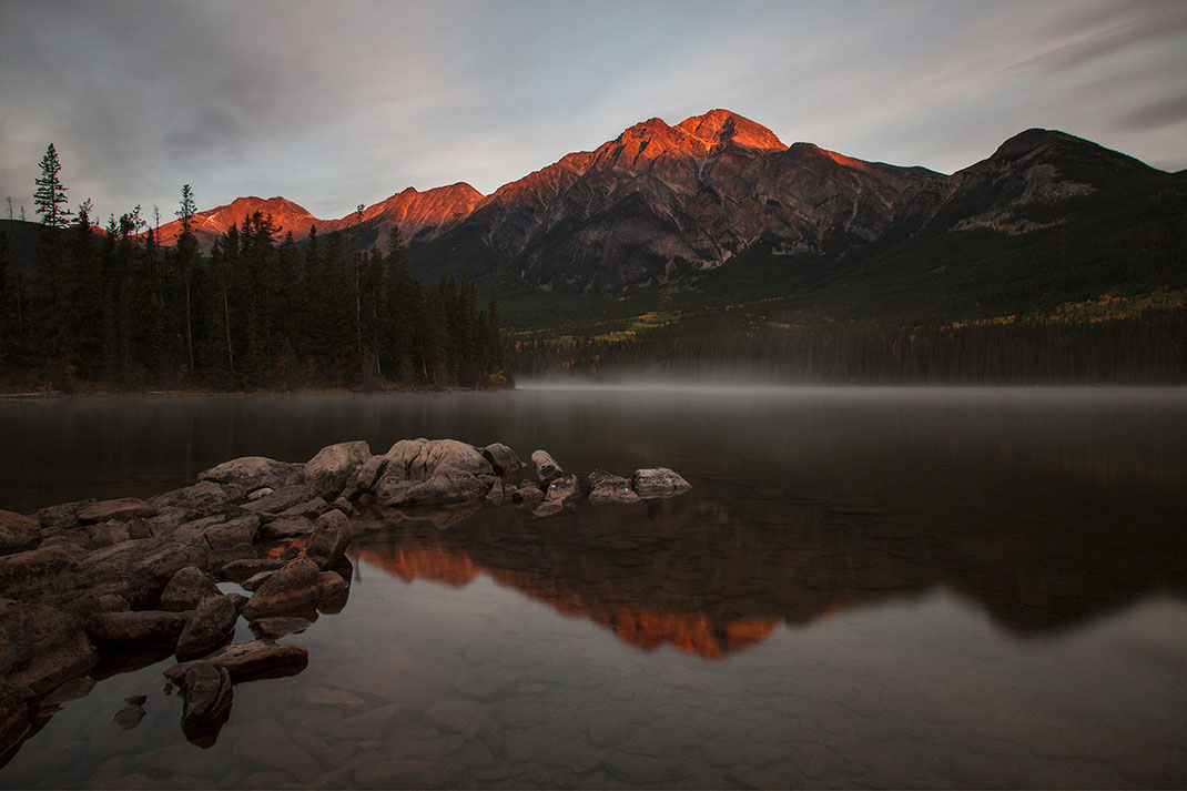 Beautiful red glowing mountain tips at pyramid lake at sunrise with reflections, long exposure, Japer National Park, Alberta, Canada, 1280x853px