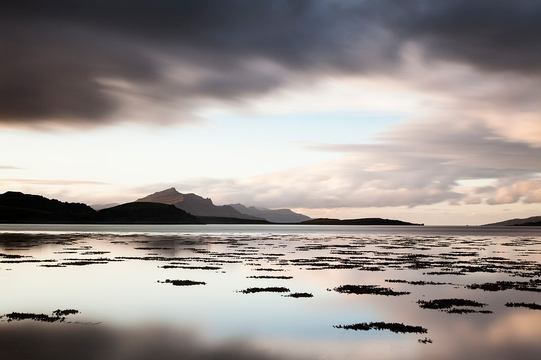 Sunset Isle of Skye, Scotland at a bay with light blue colors and light in the mountains, 1280x853px