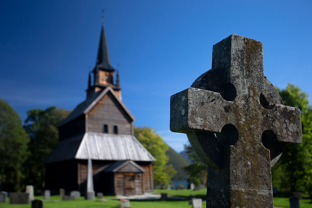Stone cross and historical wood church with beautiful weather, Kaupanger, Norway, 1280x853px