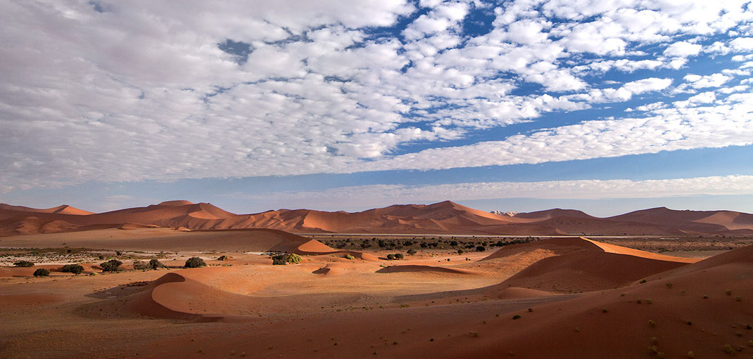 Beautiful dune landscape Sossusvlei, Namib Desertand blue sky with clouds, Namib Naukluft Park, Namibia, 1280x611px