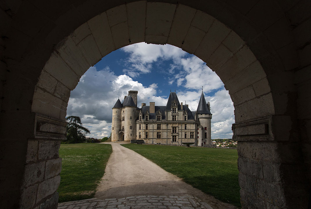 View through an arch, beautiful historical Chateau de la Rochefoucauld, Nouvelle- Aquitaine, France