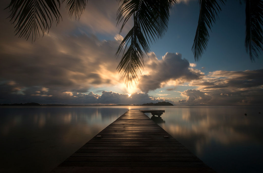 Sun rising with a jetty and palm trees, beautiful Island,  Bora Bora, South Pacific, French Polynesia, 1280x845px