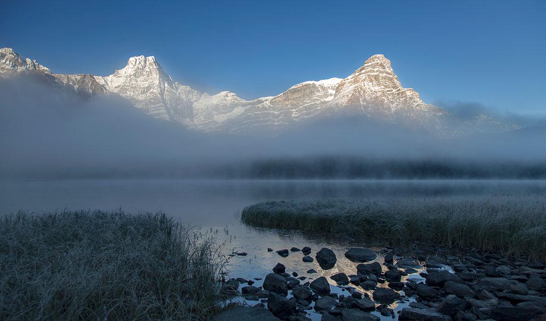 Beautiful icy frosty sunrise with fog and sunshine at amazing Waterfowl Lake, Banff National Park, Alberta, Canada, 1280x752px